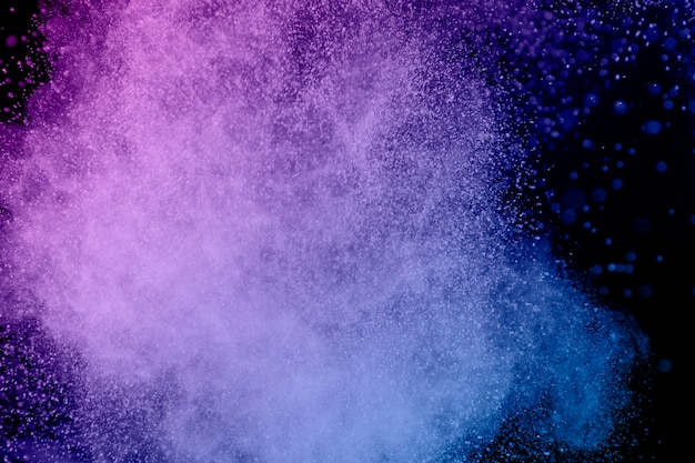 Levendige paarse vliegende poederdeeltjes Premium Foto