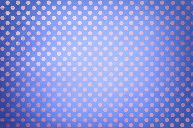 Lichtblauwe achtergrond van inpakpapier met een patroon van zilveren stipclose-up. Premium Foto