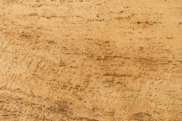 Lichtbruine marmeren oppervlaktetextuurachtergrond Gratis Foto