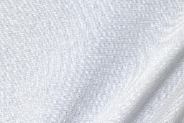 Lichte katoenen textuurachtergrond. detail van textiel textiel oppervlak. Premium Foto