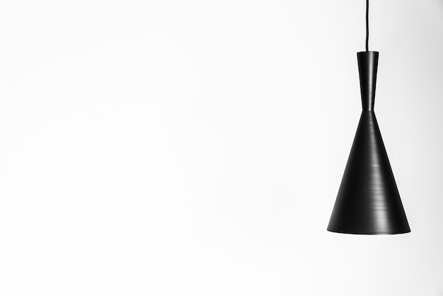 Lichte lamp op witte muur Gratis Foto