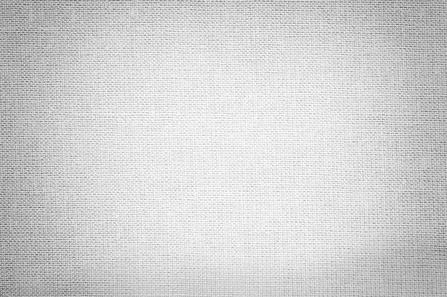 Lichtgrijze achtergrond van textiel. stof met natuurlijke textuur. Premium Foto