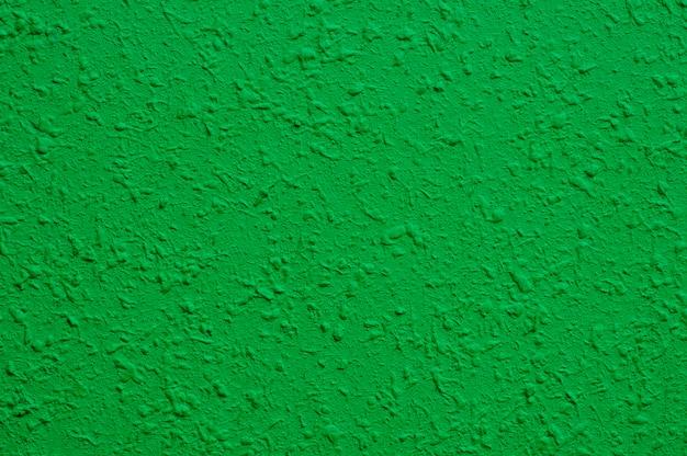 Lichtgroene betonnen muur voor interieurs, kunstbehang of artistieke textuurachtergrond Premium Foto