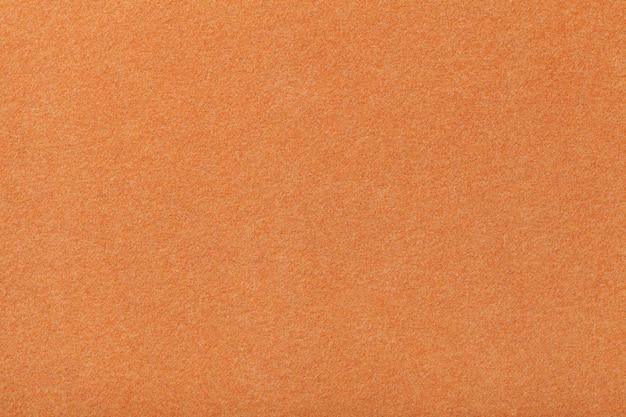 Lichtoranje mat suède stof fluwelen textuur van vilt, Premium Foto