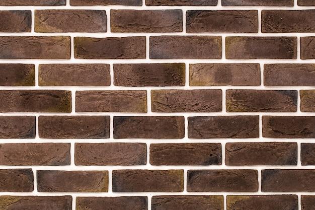 Lichtrode bakstenen muur Gratis Foto