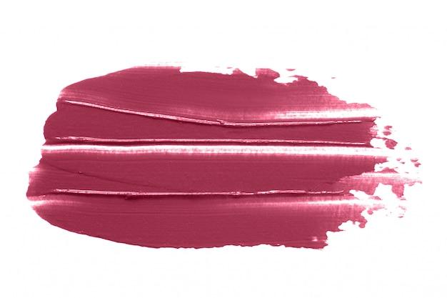 Lippenstiftvlek op wit wordt geïsoleerd dat Premium Foto