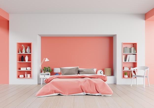 Living koraal kleur slaapkamer van luxe huis met een tweepersoonsbed en planken Premium Foto