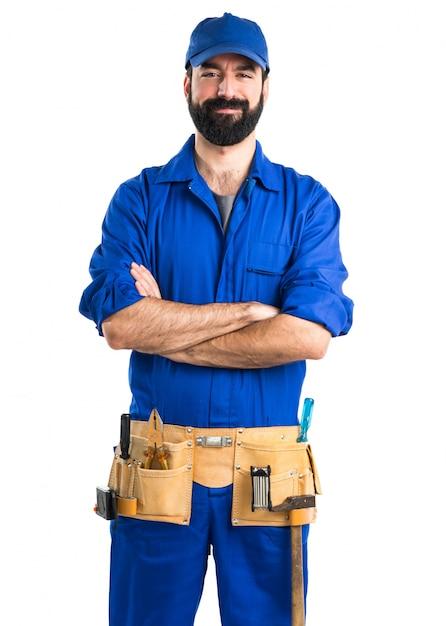 Loodgieter met zijn armen gekruist Gratis Foto