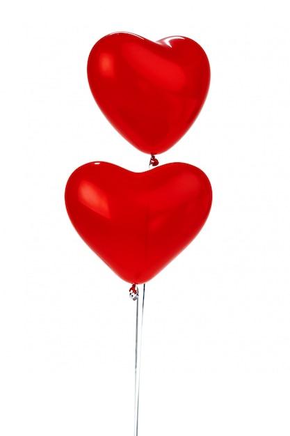 Luchtballonnen. stelletje rode hartvormige folie ballonnen Premium Foto