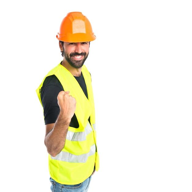 Lucky workman over geïsoleerde witte achtergrond Gratis Foto