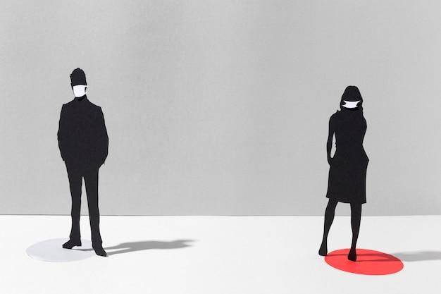 Man en vrouw met medische maskers ter bescherming van het coronavirus Gratis Foto