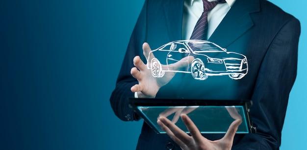 Man hand moderne digitale tablet met auto Premium Foto