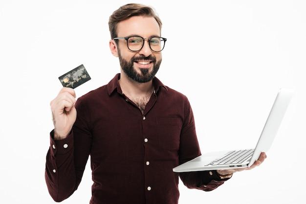 Man met pinpas en laptop computer ... online winkelen Gratis Foto