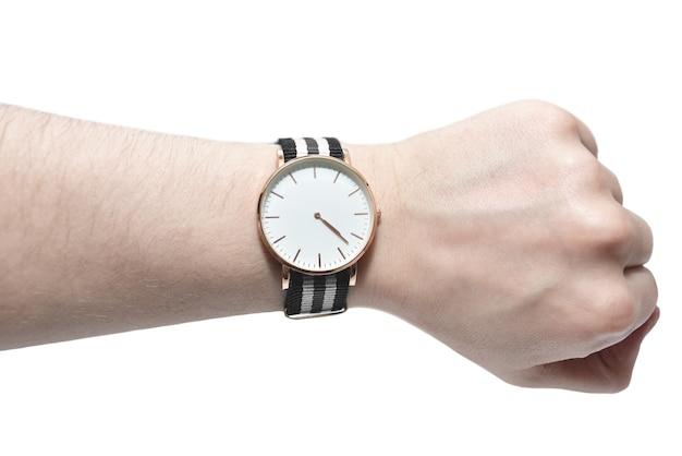 Man op zoek naar zijn horloge geïsoleerd op een witte achtergrond. tijd concept Premium Foto