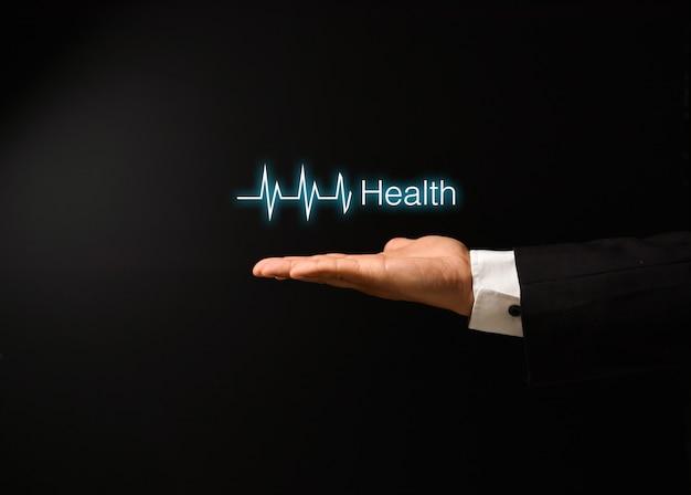 Man's hand met gezondheid conceptontwerp Premium Foto