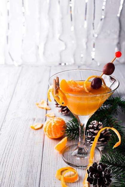 Mandarijn martini in een glas nieuwjaar Premium Foto