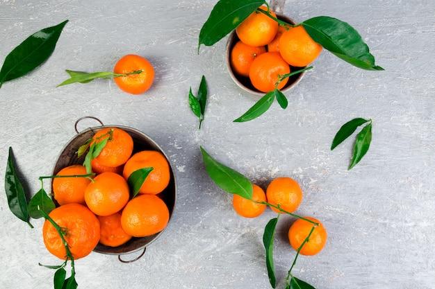 Mandarijnen achtergrond. heerlijke en mooie citrus. Premium Foto