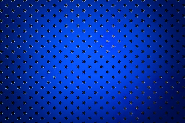 Marineblauwe achtergrond van metaalfoliepapier met een zilveren sterrenpatroon. Premium Foto