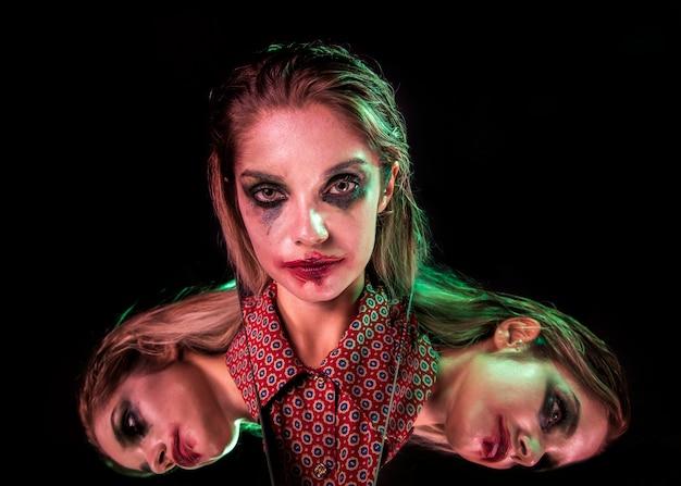 Meervoudig spiegeleffect van vrouw vanuit verschillende invalshoeken Gratis Foto