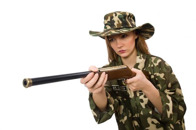 Meisje in militair eenvormig die het kanon houden die op wit wordt geïsoleerd Premium Foto