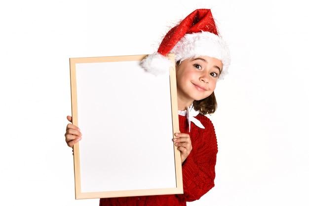 Kerstmuts Met Licht : Meisje lachend met een kerstmuts met een white board foto gratis