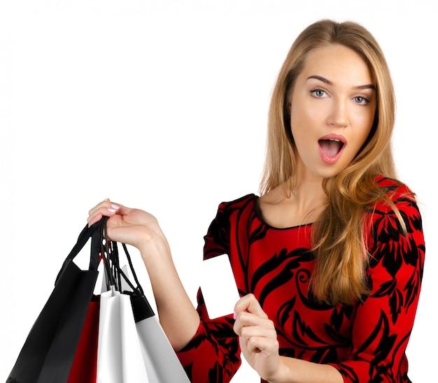 Meisje met boodschappentassen Premium Foto