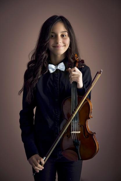 Meisje met viool Premium Foto