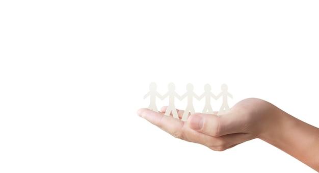 Menselijke vorm in papier gesneden met de hand of hand in hand schudden Premium Foto