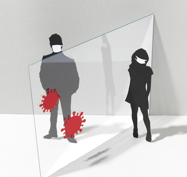 Mensen met medische maskers en glazen scheidingswand voor coronaviruspreventie Gratis Foto