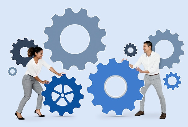 Mensen uit het bedrijfsleven verbinden met versnellingen Gratis Foto