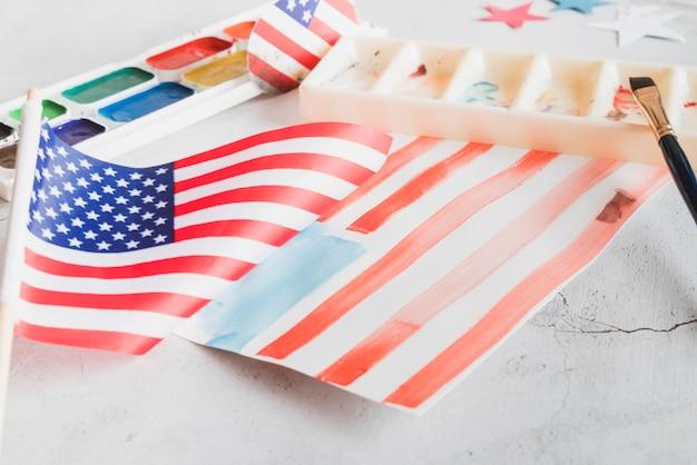 Met de hand geschilderde vs vlag met waterverfverven Gratis Foto