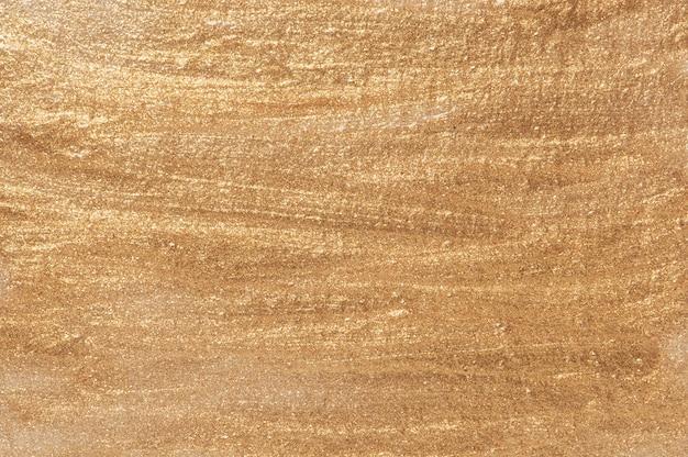Metaal gouden achtergrond Gratis Foto