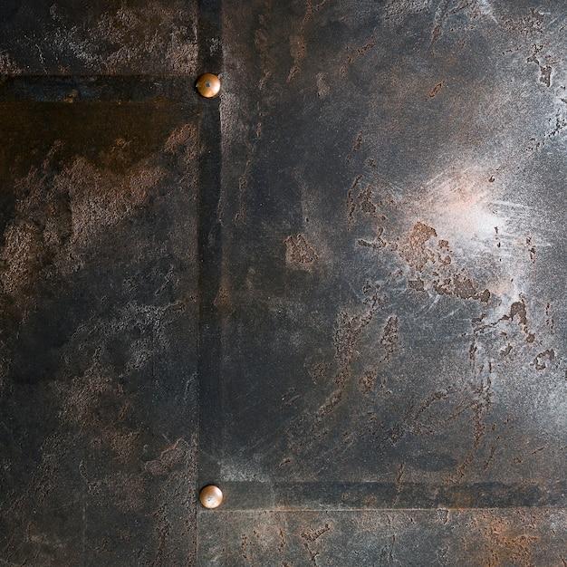 Metalen structuur met roestig uiterlijk en klinknagels Gratis Foto