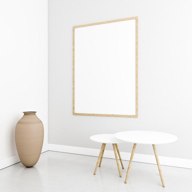 Minimalistisch interieur met elegant frame en tafels Gratis Foto
