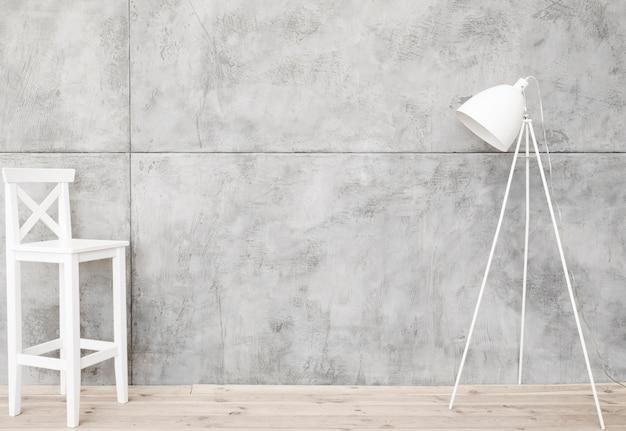 Minimalistische witte vloerlamp en kruk met betonnen panelen Gratis Foto
