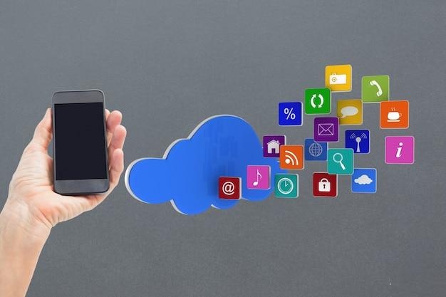 Mobiele telefoon met een wolk van applicatie-iconen Gratis Foto