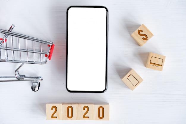 Mock up van smartphone, winkelmandje, kubussen met symbolen Premium Foto