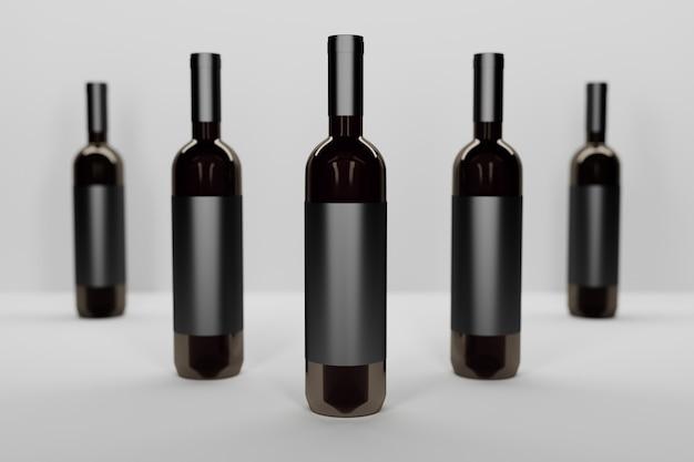 Mockupsjabloon met een rij van vijf flessen van donkere glazen wijnstokken op wit Premium Foto