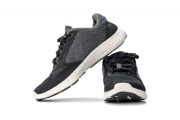 Mode lopende sneaker schoenen geïsoleerd op een witte achtergrond. Premium Foto