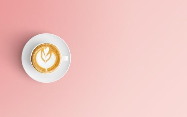 Moderne werkruimte met koffiekopje op roze kleur Premium Foto