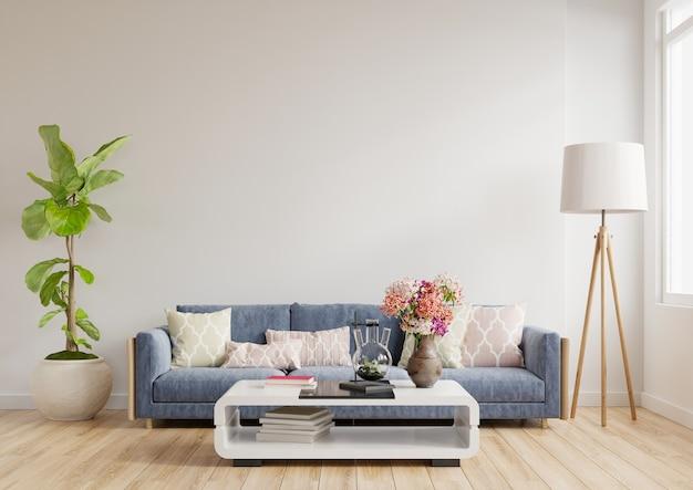 Moderne woonkamer interieur een blauwe bank op lege witte muur achtergrond, 3d-rendering Premium Foto