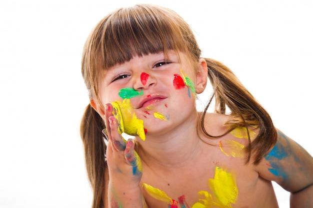 Mooi klein meisje met geschilderde gezicht Premium Foto