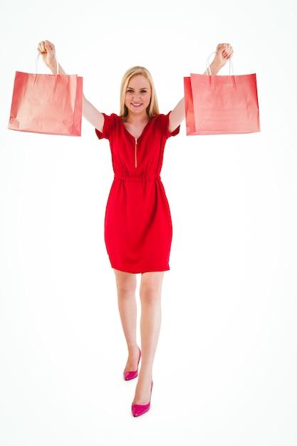 Mooie Rode Jurk.Mooie Blonde In Rode Jurk Met Boodschappentassen Foto Premium