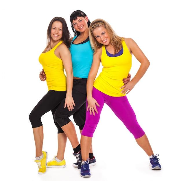 Mooie gelukkige vrouwen in fitness slijtage Gratis Foto