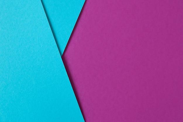 Mooie geometrische compositie met blauw en paars karton met copyspace Gratis Foto