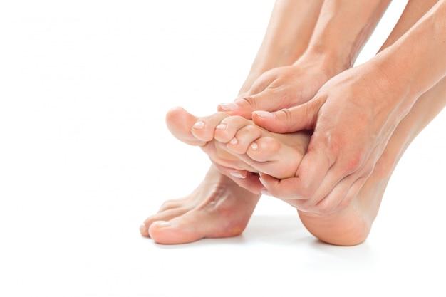 Mooie vrouwen voeten geïsoleerd Premium Foto