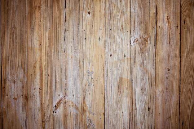 Muur gemaakt van verticale bruine houten planken Gratis Foto