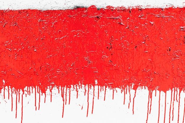Muur met rode gecorrodeerde rode verf Premium Foto