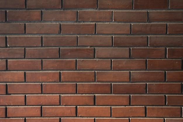Muur van donkere bakstenen Gratis Foto