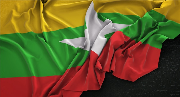 Myanmar vlag gerimpelde op donkere achtergrond 3d render Gratis Foto